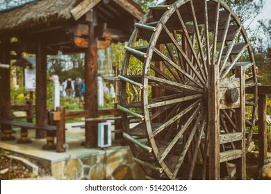 Water Wheels On River Amidst Trees in Wuxi nianhuawan park.