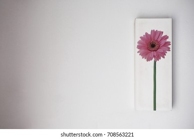 Watercolor art painting flower picture on frame hanging decorated on concrete wall  isolated on white wall background