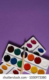watercolor paint, brush, purple background