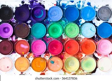 Watercolor paint palette, bright, colorful paint splatters
