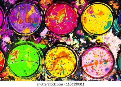Watercolor paint palette. Colorful paint splash.