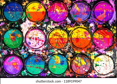 Watercolor paint palette. Colorful paint splash. Artistic background.