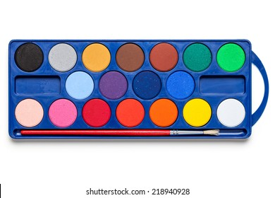 Watercolor paints box with paint brush on white background. Top view
