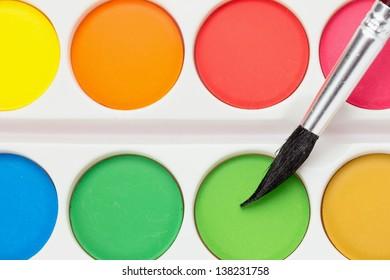 Watercolor paints set with brush, detail