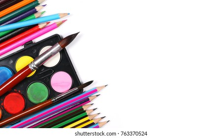Watercolor pallet, wooden color pencils and brush set for painting, isolated on white background, top view