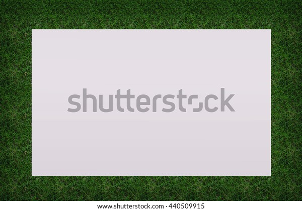 Watercolor paper on green grass background.