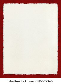 Watercolor paper with true deckled edges on a textured red background.  File includes a clipping path.