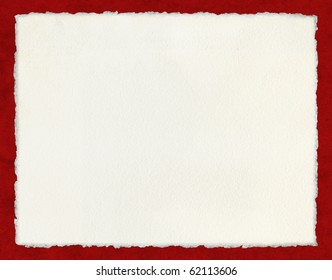 Watercolor paper with true deckled edges on a red background.