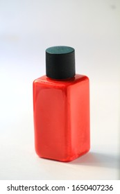 Watercolor, watercolor, red bottle, black lid On a white background.