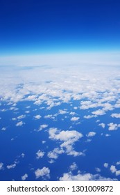 Watercolor style image of blue sky with many white cloud in vertical; shoot by mobile camera from flying airplane.
