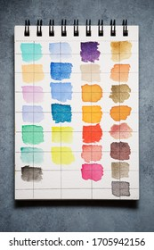 Watercolor test card on a sketchpad.
