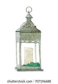 Watercolor wrought iron lantern with candle and green leaves. Hand drawn vintage illustration isolated on white background.