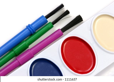 Watercolors and brushes isolated on a white background.