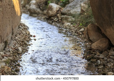 Watercourse in a traditional irrigation ditch used for channeling groundwaters
