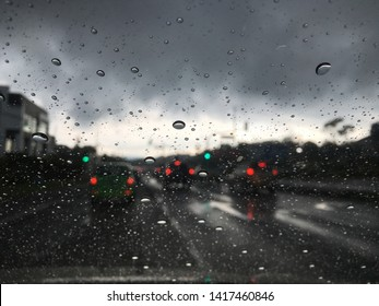 waterdrop on glass with blurry traffic