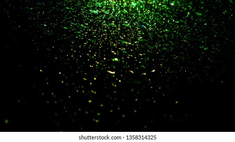 Waterdrops beading green colors on windscreen, windshield