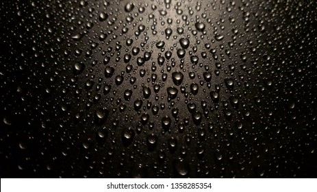 Waterdrops beading on carpaint after repellent wax coating