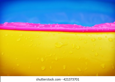 Waterdrops on swimming pool background, abstract