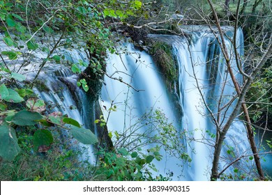 Peñalandros waterfall in the Angulo Valley within the Mena Valley municipality in the Merindades region of the province of Burgos in Castilla y Leon of Spain, Europe - Shutterstock ID 1839490315