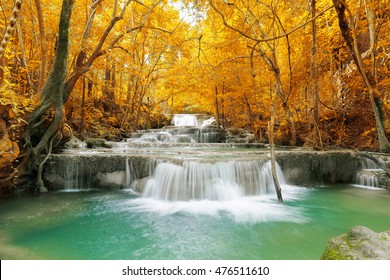 The waterfall in autumn forest of Thailand mountain, taking this image by long exposure and add fantasy colors of leaves.