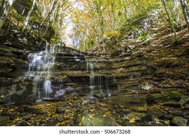 Waterfall in autumn in the Foreste Casentinesi National Park in Italy.