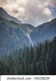 Waterfall Balea in Fagaras mountains. Rocky waterfall in the Carpathian mountains, near the Transfagarasan road.