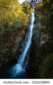 A waterfall between rocky cliffs on the top of the mountain