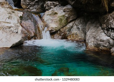Waterfall and blue river in a quiet valley