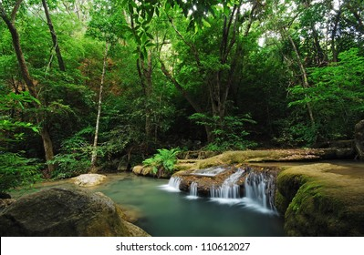 Waterfall and blue stream in the forest Thailand nature background for design