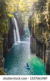 Waterfall and boat at Takachiho Gorge in Takachiho, Miyazaki, Kyushu, Japan