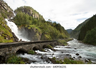 Waterfall and bridge in Norway in a summer cloudy day