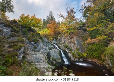 Waterfall in a canyon in the High Fens, Ardennes, Belgium with rotating vortex, long exposure shot