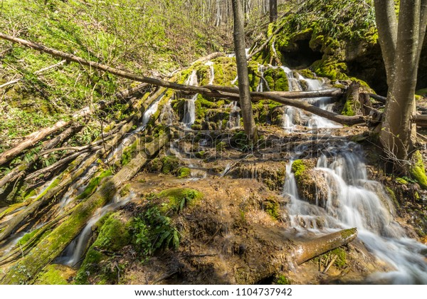 Waterfall cascade covered with beautiful green moss.