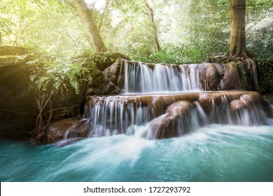 Waterfall and cascades in the jungle forest in Thailand. beautiful forest landscape, trees water and sun