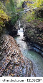 Waterfall Cascading In a Deep Chasm in an Autumn Forest Setting; Peaceful, Tranquility, Save the Environment