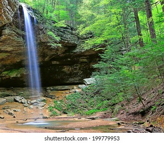 The waterfall cascading over Ash Cave in Hocking Hills State Park, Ohio.
