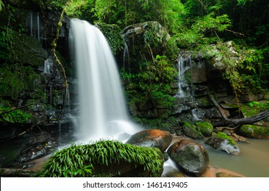 Waterfall from the cliff in rainy season with green forest