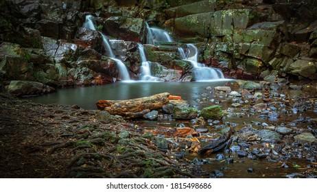 waterfall of colored stones between rocks