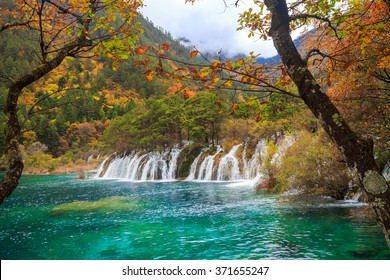Waterfall with colorful  forest in Jiuzhaigou