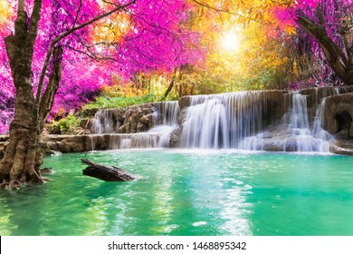 Waterfall colorful leaves in the summer is a beautiful waterfall with clear, flowing water, soft, emerald green color, suitable for relaxing, playing,