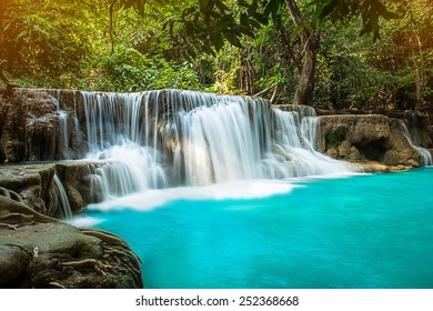 waterfall with day noon light in tropical forest,