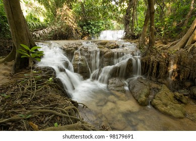 Waterfall in deep forest .