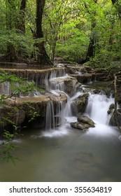 Waterfall in the deep jungle forest named Huay Mae KhaMin in Kanchanaburi province, Thailand