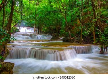 Waterfall in deep rain forest jungle. (Huay Mae Kamin Waterfall in Kanchanaburi Province, Thailand)
