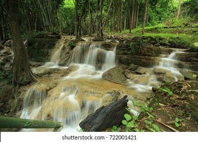 Waterfall in deep rain forest jungle (Pha Tat Waterfall in Kanchanaburi Province, Thailand)