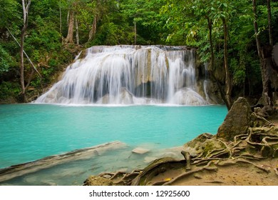 Waterfall in Erawan National Park with natural swimming pool in the tropical forest of Kanchanaburi province in Thailand.