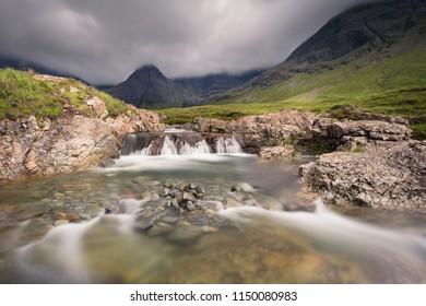 Waterfall in the Fairy Pools rocky stream on Isle of Skye landscape