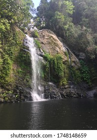Waterfall falling into creek in the Daintree rainforest in Queensland, Australia