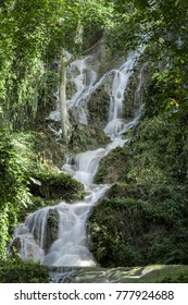 Waterfall flowing from the cliffs. Natural