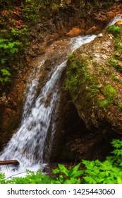 Smaé waterfall flowing down a big rock